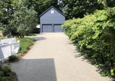 Yellow Oil and Stone Driveway to 2-Car Garage